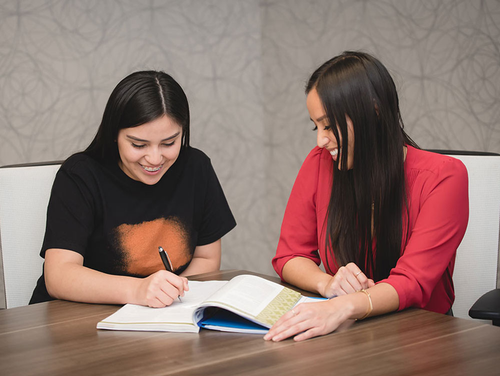 A corporate employee mentors a high school student at her workplace